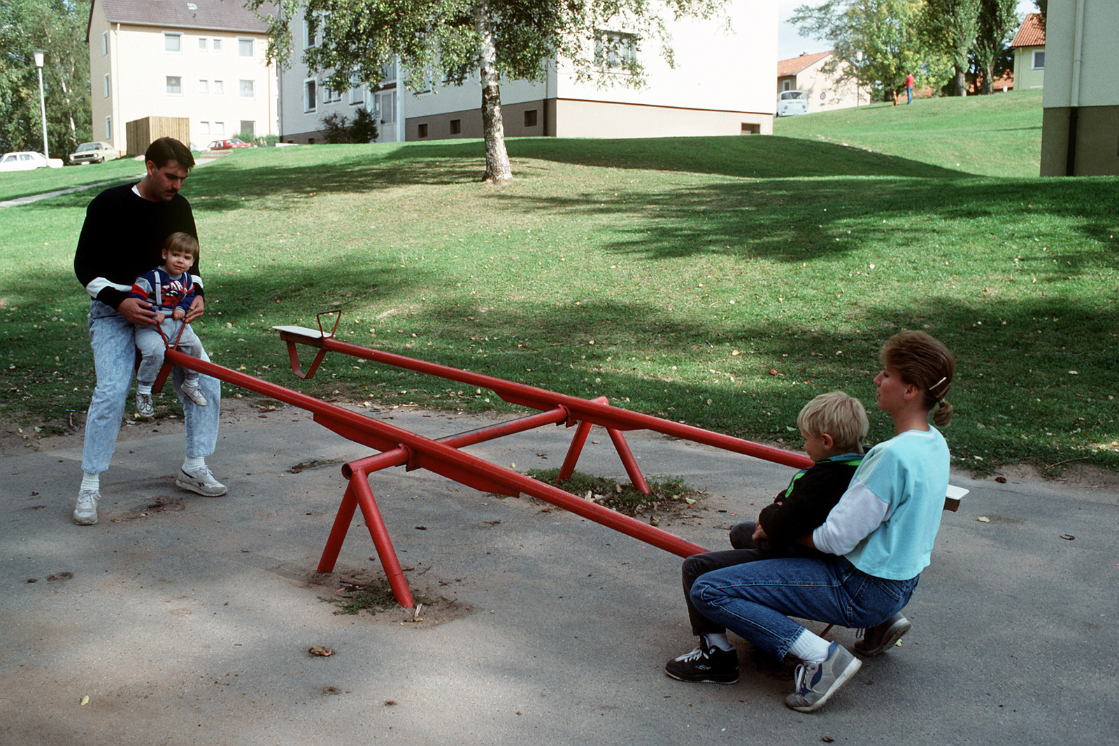 STAFF SGT. David and SGT. Sandra McClellan play with their children near their quarters. The McClellans are among the many military families soon to be affected by the closing of Zweibruecken, scheduled for early 1992