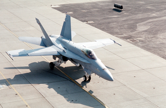 The first F/A-18C(N) Hornet aircraft to be delivered to Strike Fighter Squadron 147 (VFA-147) taxis on the runway following its arrival at the air station from McDonnell-Douglas corporate facilities in St. Louis. The squadron is making the transition from A-7E Corsair II aircraft to the more technologicaly advanced Hornet