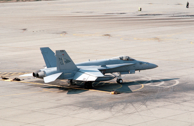The first F/A-18C(N) Hornet aircraft to be delivered to Strike Fighter Squadron 147 (VFA-147) stands on the flight line following its arrival at the air station from McDonnell-Douglas corporate facilities in St. Louis. The squadron is making the transition from A-7E Corsair II aircraft to the more technologicaly advanced Hornet