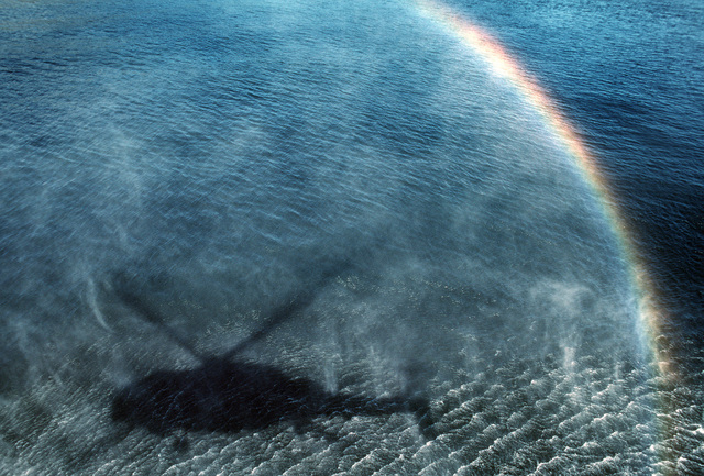 The rotors of an SH-2 Seasprite helicopter stir up mist to create a rainbow during Unitas XXXI, an annual, joint exercise between the U.S. Navy and the naval forces of nine South American countries