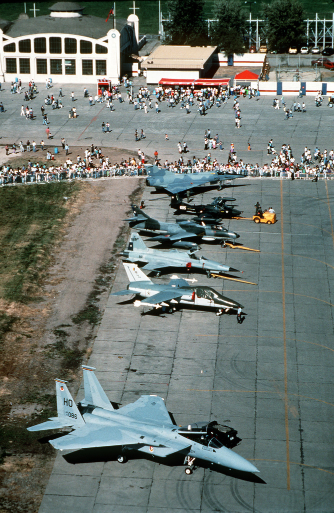Various aircraft stand on the flight line in preparation for participation in the international air show, FIDAE 90. The planes include, from foreground: a 49th Tactical Fighter Squadron F-15 Eagle aircraft, a Brazilian A-1 aircraft, a Chilean F-5 Tiger II aircraft, a Chilean FGA-71 Hunter aircraft, a Chilean A-37B Dragonfly aircraft, and a Chilean Mirage 50 aircraft