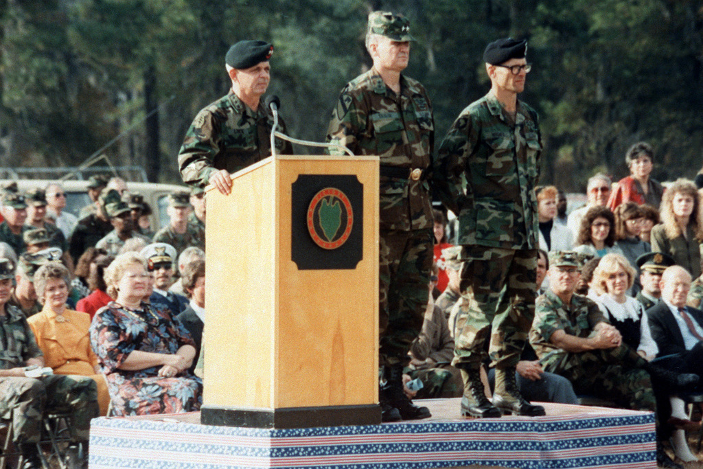 LT. GEN. Gary E. Luck, commanding general, U.S. Army Special Operations Command, speaks at a ceremony marking the return of the 1ST Battalion, 75th Ranger Regiment, from Panama, where it participated in Operation Just Cause. Also on the platform are MAJ. GEN. Horace G. Taylor, center, commanding general, 24th Infantry Division (mech.), and LT. COL. Robert W. Wagner, commanding officer, 1ST Battalion, 75th Ranger Regiment