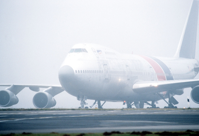 A commercial 747 aircraft stands on the flight line at Luxembourg International Airport after transporting members of the 1ST Battalion, 22nd Infantry, 10th Mountain Division to Luxembourg. The troops are en route to West Germany during exercise REFORGER '90