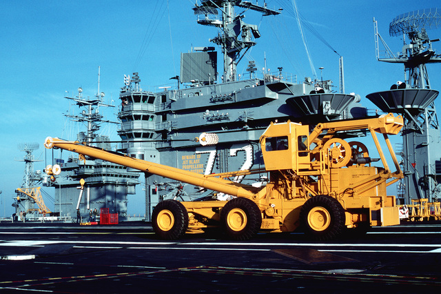 A crash and recovery crane is parked on the flight deck of the nuclear-powered aircraft carrier USS ABRAHAM LINCOLN (CVN-72). This crane replaces the NP-50 mobile cranes previously used aboard carriers of the Atlantic Fleet