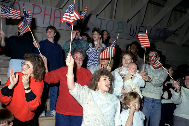 Friends and family members are on hand to welcome the soldiers of the 4th Battalion, 6th Infantry Regiment, who are returning from Panama, where they participated in Operation JUST CAUSE