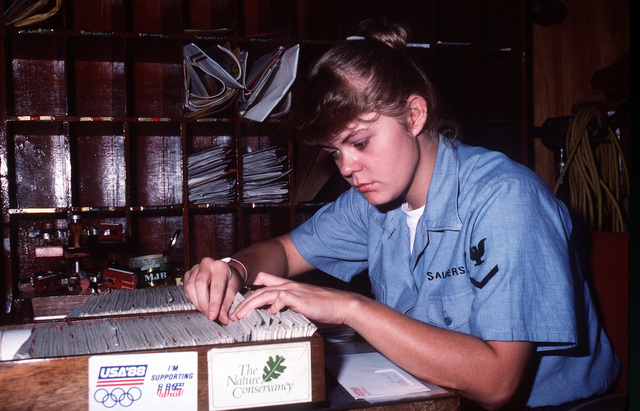Postal Clerk 3rd Class Lisa Saunders sorts through incoming mail at the air station post office