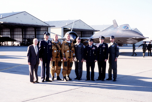 After the final operational flight of an SR-71 high-altitude reconnaissance aircraft, visiting dignitaries gather around the crew for a photograph. Present are, from left to right: an unidentified representative of Lockheed Aircraft Corp., GEN John T. Chain, LTC Thomas E. Bergam, LTC William R. Dyckman, COL James S. Savarda, LGEN Richard A. Burpee, BGEN Kenneth F. Keller and LTC Smith