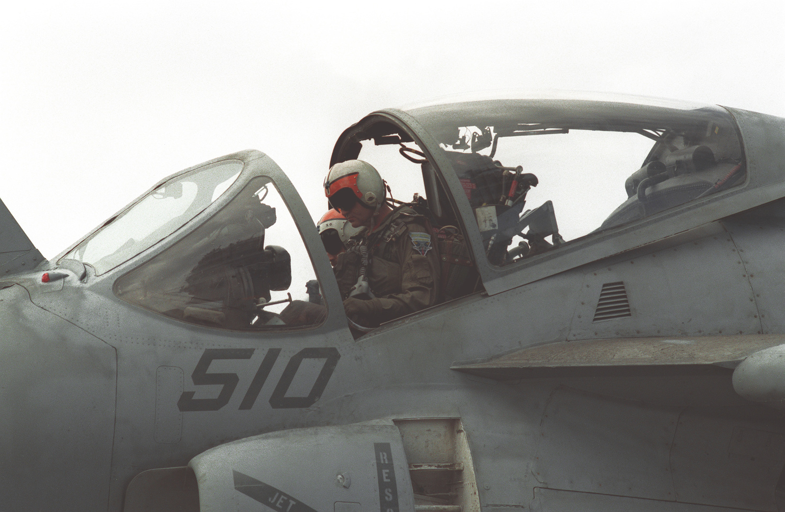 The pilot and bombardier-navigator aboard the A-6E Intruder aircraft on the flight deck of the nuclear-powered aircraft carrier USS ABRAHAM LINCOLN (CVN-72) make final preparations for launch during the LINCOLN's shakedown cruise