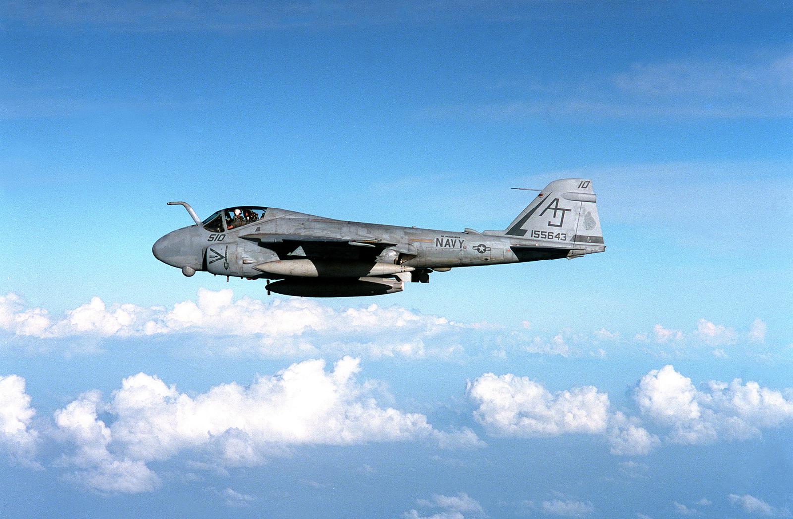 A left side view of an Attack Squadron 65 (VA-65) A-6E Intruder aircraft in flight. The aircraft is based aboard the nuclear-powered aircraft carrier USS ABRAHAM LINCOLN (CVN-72) during the ship's shakedown cruise