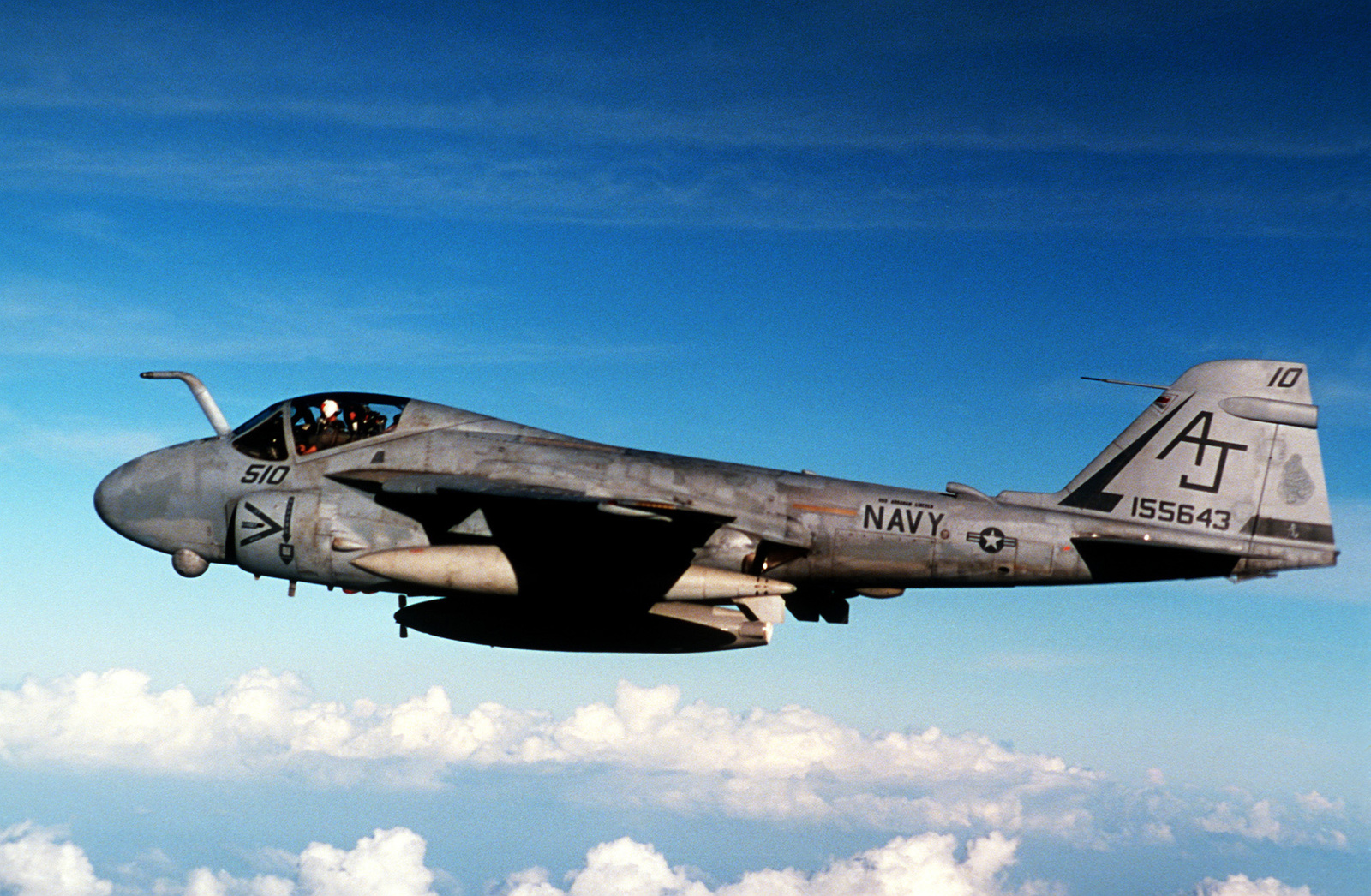 A left side view of an Attack Squadron 65 (VA-65) A-6E Intruder aircraft in-flight. The aircraft is based aboard the nuclear-powered aircraft carrier USS ABRAHAM LINCOLN (CVN-72) during the shakedown's cruise