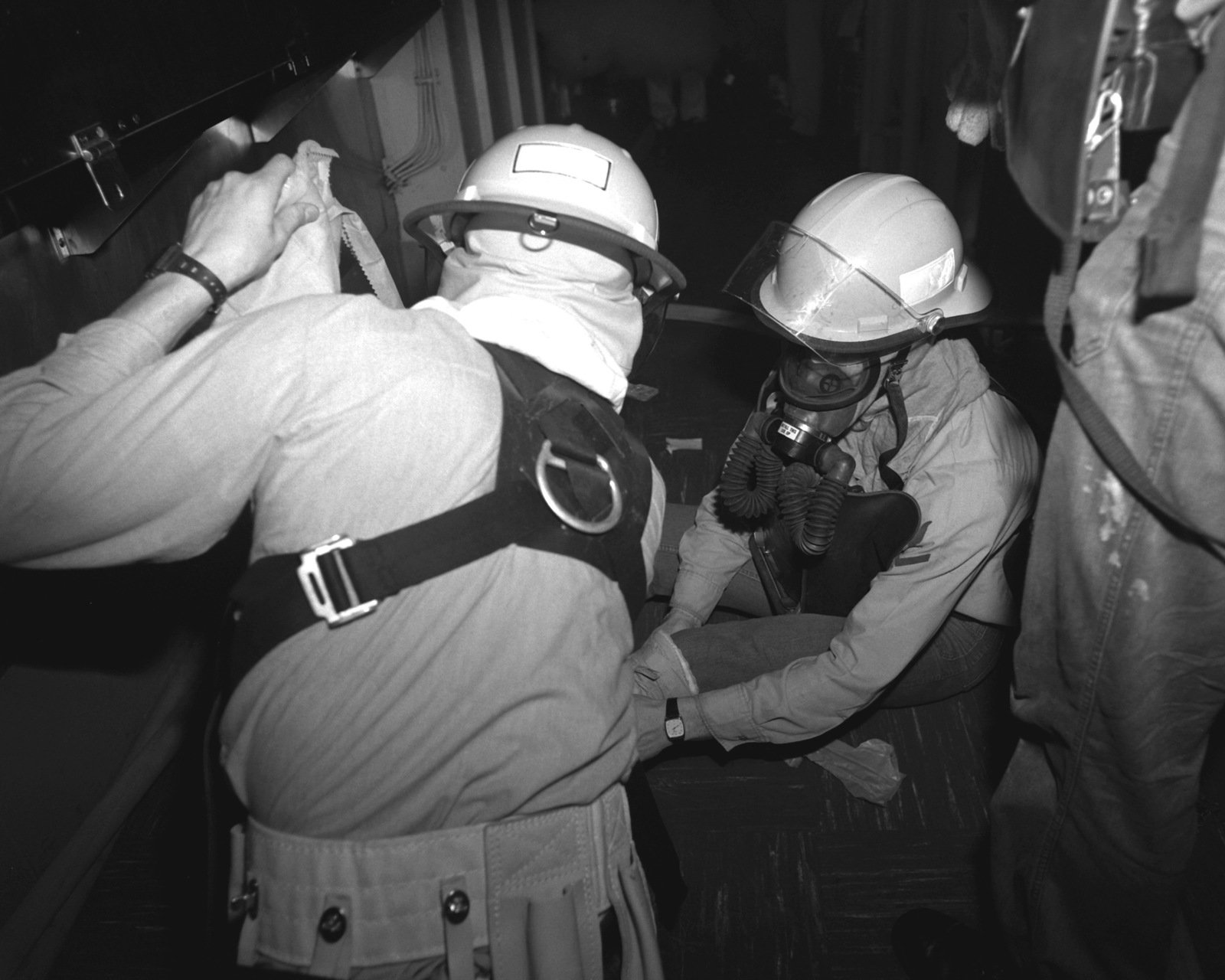 Firefighters stop to check on a simulatd casualty during a firefighting drill aboard the nuclear-powered aircraft carrier USS ABRAHAM LINCOLN (CVN-72). The LINCOLN's crew is receiving refresher training under the supervision of personnel from Fleet Training Group, Guantanamo Bay, Cuba