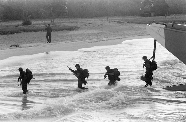 Marines from the 2nd Light Armored Infantry Battalion, 4th Marine Regiment, wade ashore from a utility landing craft (LCU) during Fleet Ex 1-90
