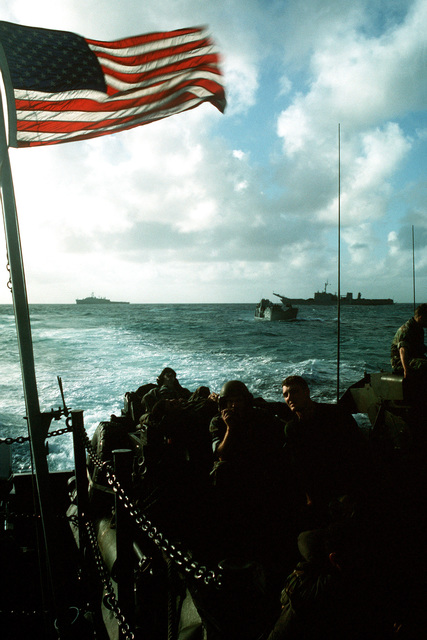 Marines of the 2nd Light Armored Infantry Battalion, 4th Marine Regiment, sit atop their vehicles as they ride toward the beach at Vieques, Puerto Rico, aboard a utility landing craft (LCU) during Fleet Ex 1-90