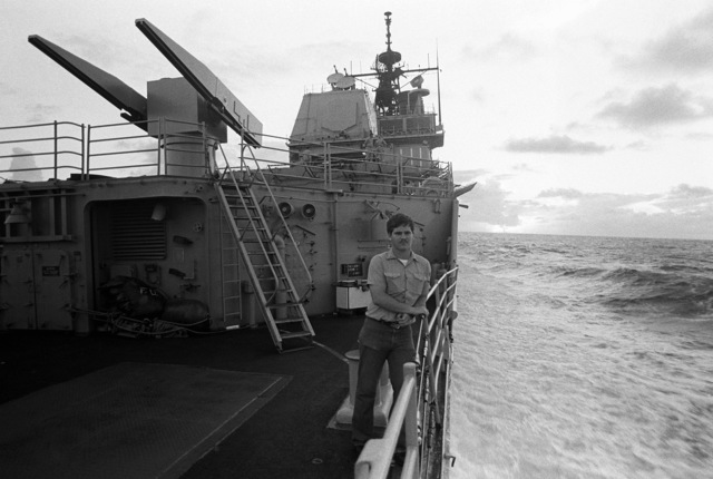 A crew member takes a break on the guided missile cruiser USS TICONDEROGA (CG-47) during Fleet Ex 1-90. A Mark 26 missile launcher is seen in the background