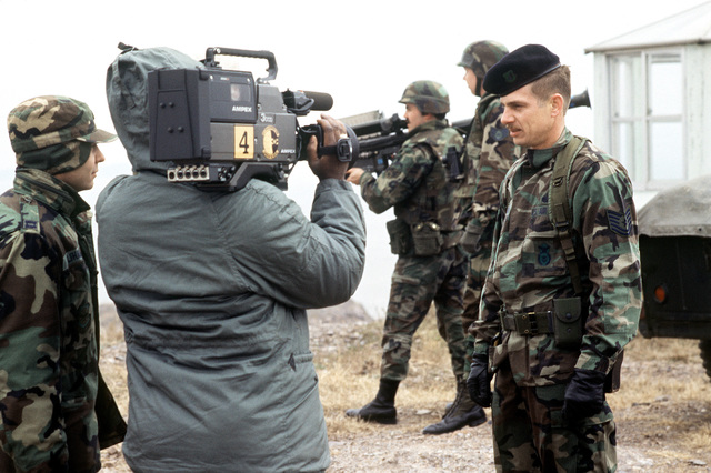 Aerospace Audiovisual Service videographer uses a Sony Betacam to records an on-camera interview with a participant in joint training exercise, TEAM SPIRIT '90. Exact Date Shot Unknown