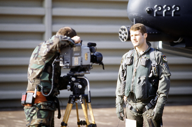 An Aerospace Audiovisual Service videographer using a Sony Betacam tapes an on-camera interview with an A-10 pilot during joint training exercise, TEAM SPIRIT '90. Exact Date Shot Unknown