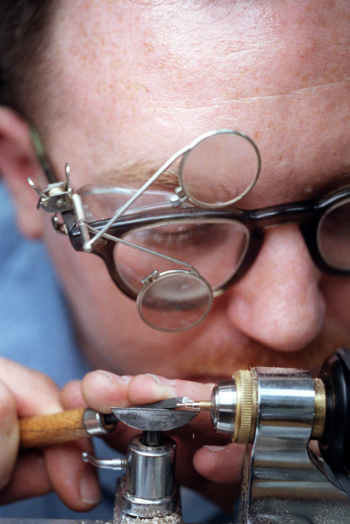 An instrumentman uses a lathe during a course at the Opticalmen and Instrumentmen School