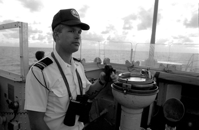 An officer stands watch on the open-air bridge aboard the Canadian frigate HMCS MARGAREE (DDH 230) during FLEET EX 1-90