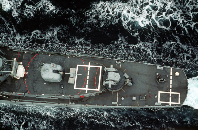 An overhead view of the stern section of the guided missile destroyer USS BUCHANAN (DDG-14) as the ship is underway near San Diego