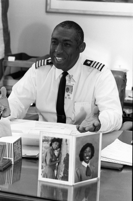 CAPT Mack C. Gaston converses with a visitor in his office at the Pentagon. Gaston has recently been selected to receive his promotion to the rank of rear admiral (lower half)