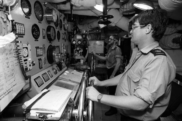 Sailors man their stations in an engineering space aboard the Canadian frigate HMCS MARGAREE (DDH-230) during Fleet Ex 1-90