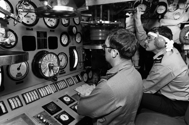 Sailors monitor the gauges on a control panel in the engine room aboard the Canadian frigate HMCS MARGAREE (DDH-230) during Fleet Ex 1-90