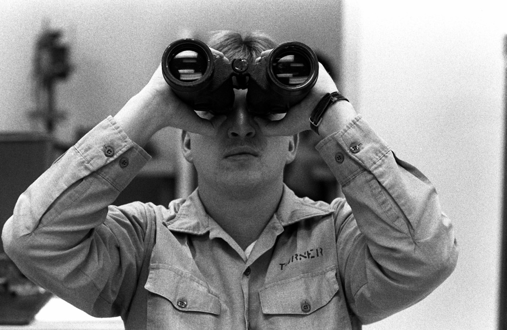 SEAMAN Chip Turner adjusts binoculars in the Optical Navigation Equipment Class at the Opticalmen and Instrumentmen School