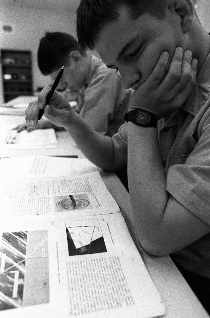 SEAMAN Recruit Jeb Monk studies a training manual at the Opticalmen and Instrumentmen School