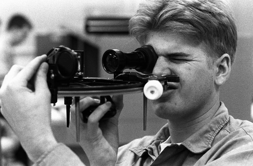 SEAMAN Recruit Scott Morgan inspects the horizon mirror alignment in a sextant during training at the Opticalmen and Instrumentmen School