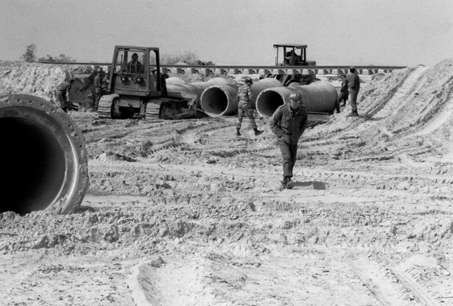 US Navy Seabees prepare to move cement culverts with crawler tractors during exercise ATLAS RAIL, a Seabee project to repair a flood-damaged railway