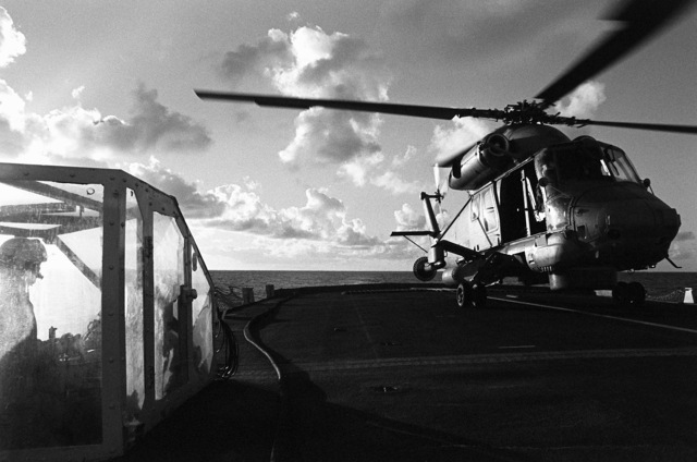 An SH-2F Seasprite helicopter from Light Helicopter Anti-submarine Squadron 36 (HSL-36) prepares to lift off from the flight deck of the Canadian frigate HMCS MARGAREE (DDH-230) during Fleet Ex 1-90