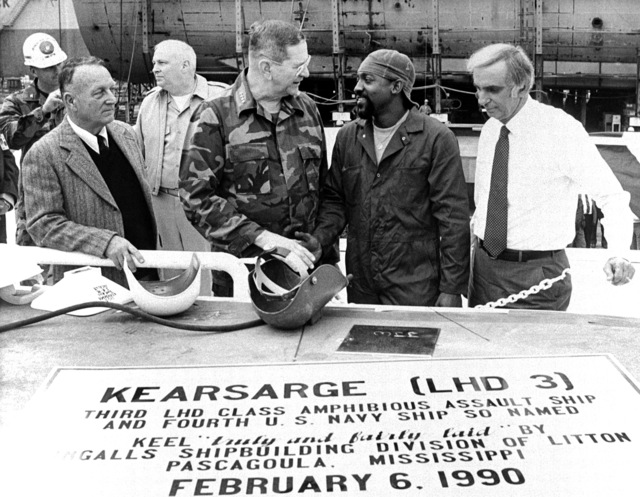 General Joseph J. Went, third from right, assistant Commandant of the Marine Corps, shakes hands with Willie Willis Jr., a welder at Ingalls Shipbuilding, after authenticating the keel plaque for the amphibious assault ship KEARSARGE (LHD 3). Also attending are, from left: an unidentified Marine colonel: E.E. Shoults, program manager, Amphibious Warfare and Strategic Sea Lift Program; and Captain J.F. King. At right is Jerry St. Pe', President of Ingalls Shipbuilding