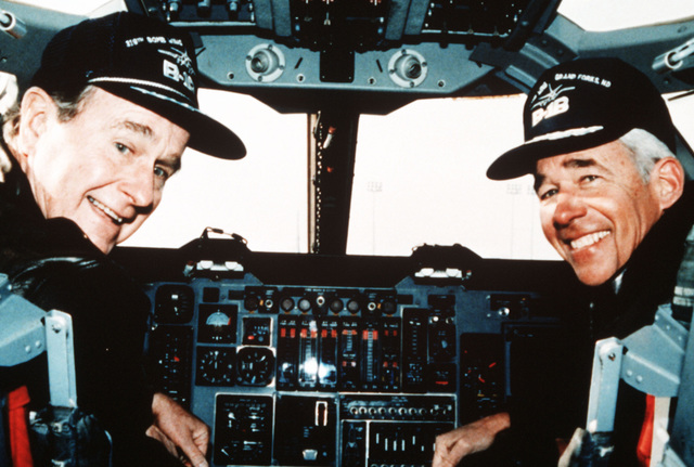 President George Bush, left, and GEN Jack Chain, Commander in CHIEF, Strategic Air Command (SAC), sit in the cockpit of a B-1B aircraft during the president's visit