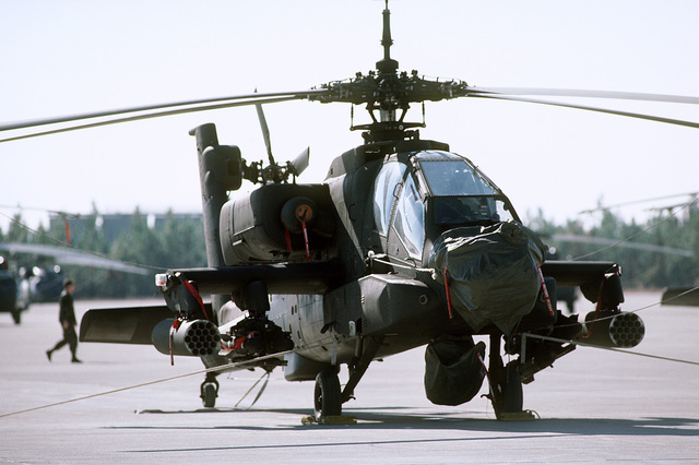 An AH-64 Apache assault helicopter is parked on the flight line prior to an Army flying mission. Air Force Detachment 3, 5th Weather Squadron provides airborne weather teams to support Army aviation units such as the XVIII Airborne Corps and subordinate units, including the 82nd Airborne Division, 1ST Special Operations Command and the 7th Special Forces Group