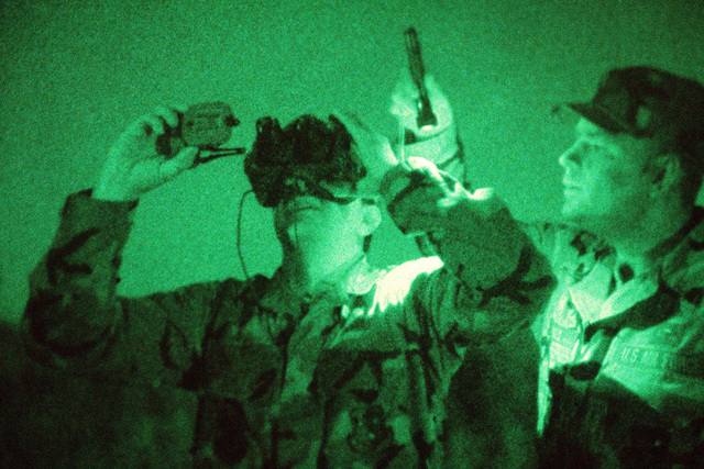 MASTER Sergeant Stephen Lord provides lighting assistance as STAFF Sergeant Ronald Kellerman checks weather conditions at a drop zone. Both men are members of Detachment 3, 5th Weather Squadron, an Air Force unit which provides airborne weather teams to support the Army's XVIII Airborne Corps and subordinate units, including the 82nd Airborne Division, 1ST Special Operations Command and the 7th Special Forces Group