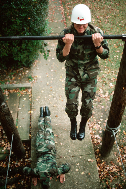 SENIOR AIRMAN Gerald Webber, Detachment 3, 5th Weather Squadron, does pull-ups during an exercise session outside detachment headquarters. The Air Force detachment provides airborne weather teams to support the Army's XVIII Airborne Corps and subordinate units, including the 82nd Airborne Division, 1ST Special Operations Command and the 7th Special Forces Group