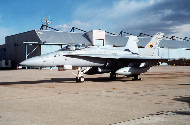 An F/A-18C Hornet aircraft of Strike Fighter Squadron 146 (VFA-146) stands on the flight line