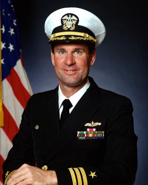 Commander (CDR) Rick G. Merten, USN (covered)