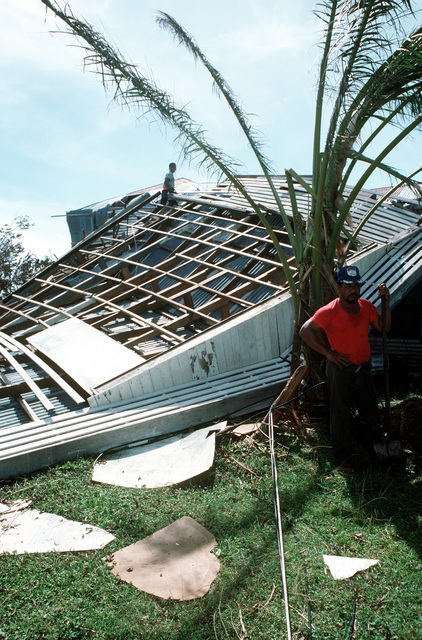 A workman stands by a demolished building in the village of Tuasivi on the island of Savaii during disaster relief efforts in the area. The building is one of many structures which sustained damage from Cyclone Ofa, which hit Savaii and the island of Upolu