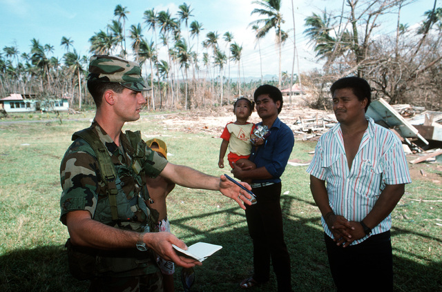 MAJ (Dr.) Cloonan plans a medical assessment of the villagers of Tuasivi during disaster relief efforts on the island of Savaii in the aftermath of Cyclone Ofa
