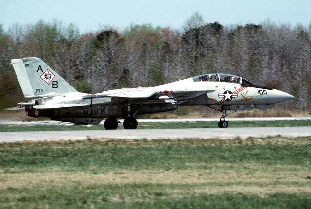 A right side view of a Fighter Squadron 102 (VF-102) F-14A Tomcat aircraft rolling along the runway