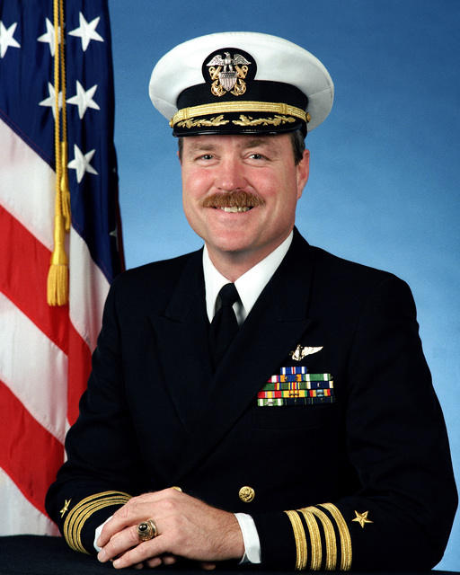 Captain Craig C. Steidle, USN (covered)