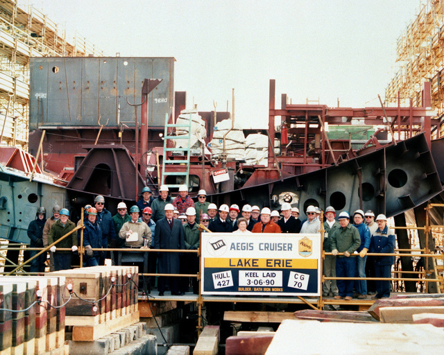 Officials and construction crew members pose for a group photograph to commemorate the keel laying of the guided missile cruiser LAKE ERIE (CG 70)