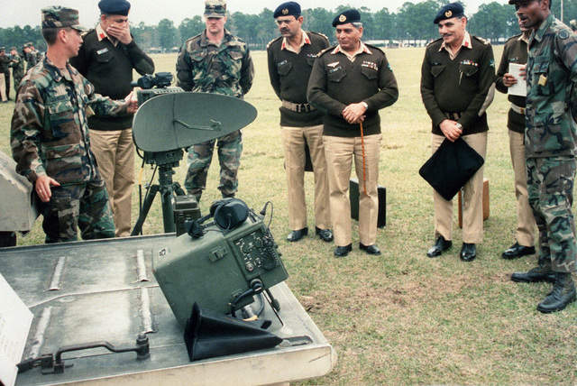 A soldier explains an AN/PPS-5B battlefield surveillance radar to members of the Pakistani army's general staff. LT. GEN. Shamin Alan Khan, chief of the general staff, is second from right
