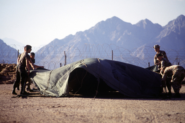 Airmen from the 435th Tactical Airlift Wing's airlift control element (ALCE) and the 4th Mobile Aerial Port Squadron set up a tent near the Ras Nusrani airfield. The airmen are in Egypt to coordinate aircraft operations connected with the arrival and departure of United States forces serving with the Multinational Force and Observers (MFO) peacekeepers on the Sinai Peninsula