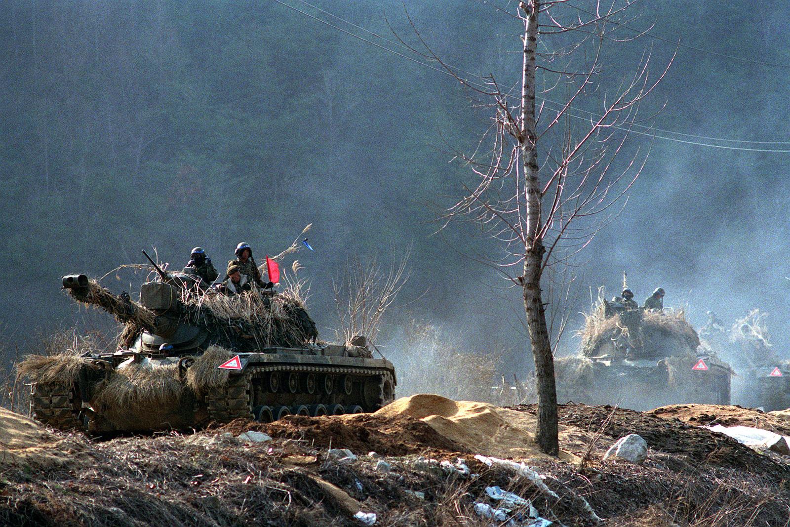 A column of South Korean M-48 main battle tanks advances along a road during the combined South Korean/U.S. exercise Team Spirit '90