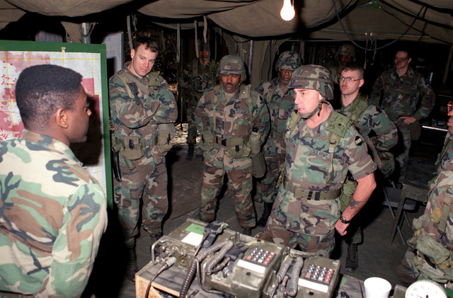 SGM Robert F. Beach, command sergeant major, Forces Command (FORSCOM), talks with soldiers of the 2nd Brigade, 5th Infantry Division (Mechanized), who were participating in a field exercise during his visit to the base