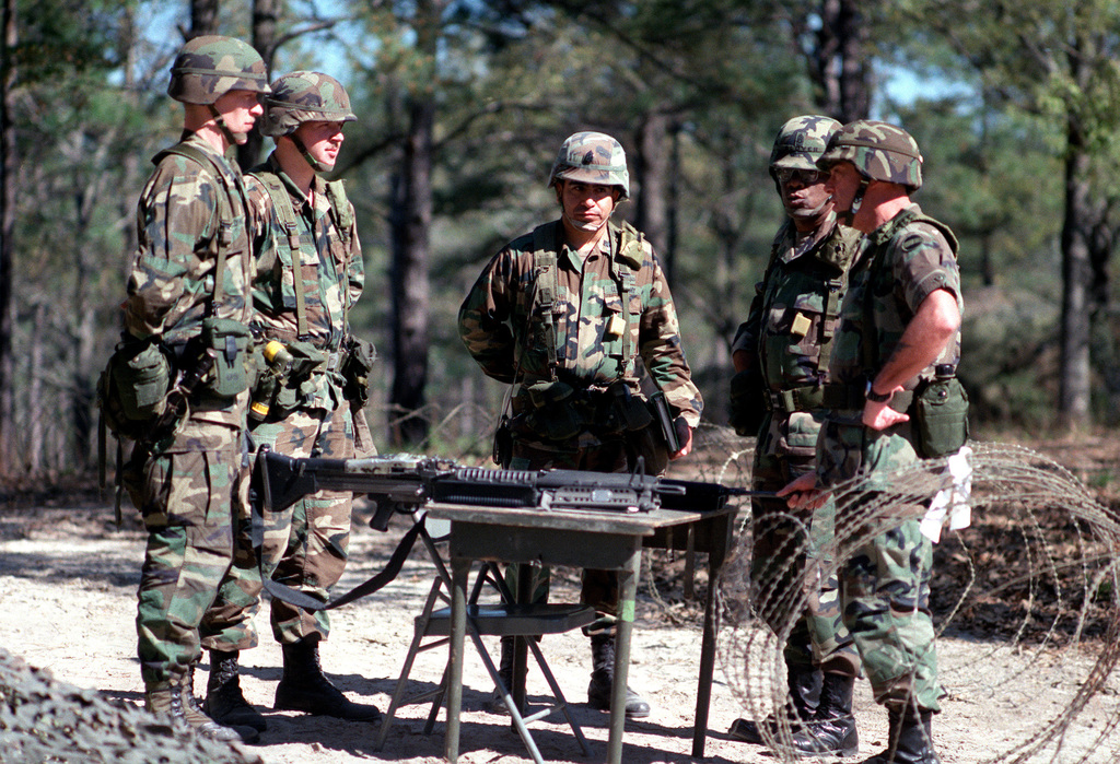 SGM Robert F. Beach, right, command sergeant major, Forces Command (FORSCOM), talks with soldiers of the 2nd Brigade, 5th Infantry Division (Mechanized), who were participating in a field exercise during his visit to the base.  Standing beside Beach is SGM Frankie L. Glover, command sergeant major, 5th Infantry Division