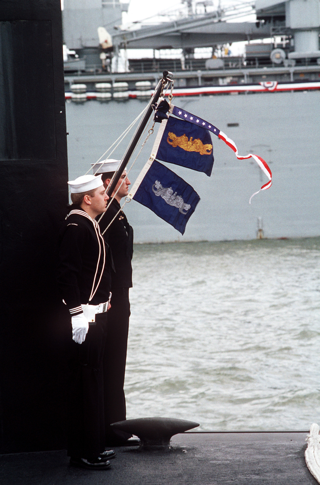 The ship's commissioning pennant, along with the pennants of the gold and blue crews, are raised aboard the nuclear-powered attack submarine USS ALBANY (SSN 753) during the vessel's commissioning ceremony