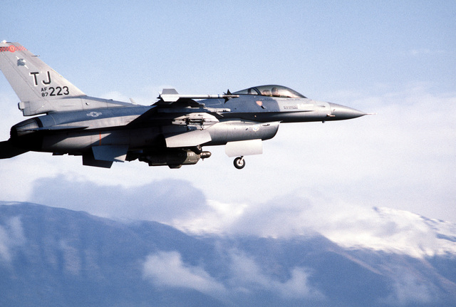 A 401st Tactical Fighter Wing (401st TFW) F-16C Fighting Falcon aircraft carrying an AN/ALQ-131 electronic counter measures (ECM) pod beneath its fuselage retracts its landing gear upon takeoff during a Salty Nation exercise. The 401st TFW has deployed to Aviano from Torrejon Air Base, Spain, for the exercise